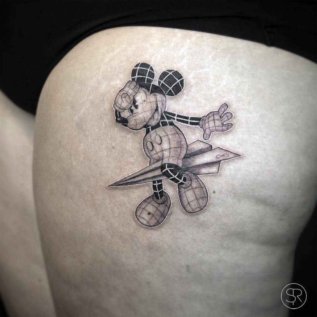 Mickey mouse on a paper plane tattoo