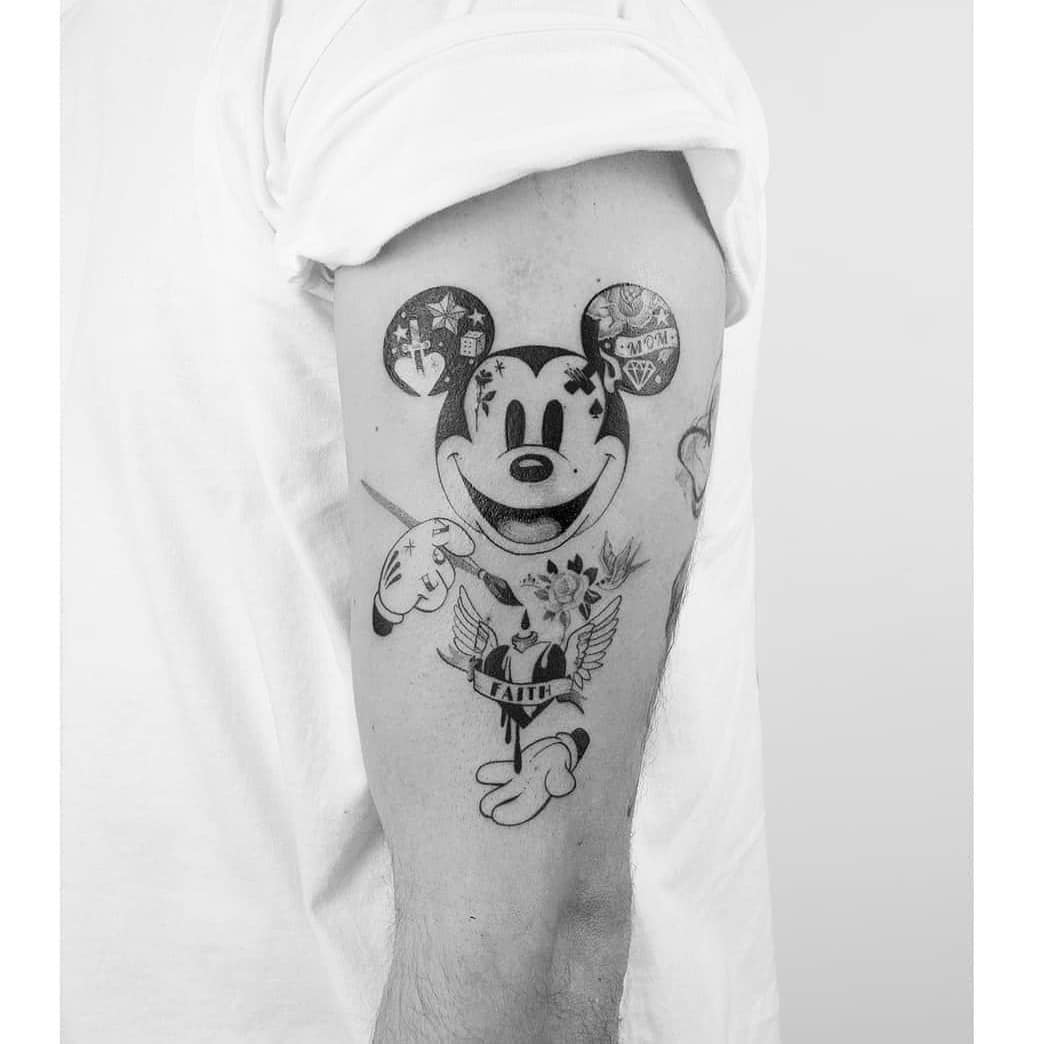 Mickey mouse painting a heart saying faith tattoo