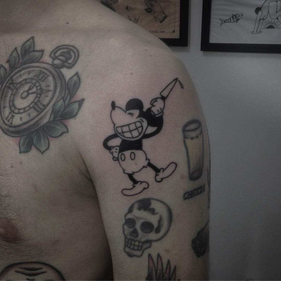 Mickey mouse with a knife tattoo