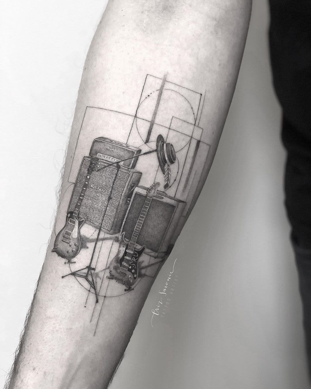 Tattoo of the instruments of a rock band