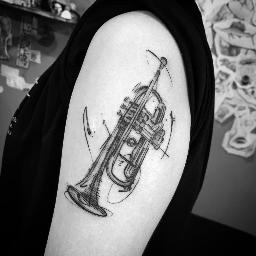 Tattoo of a trumpet in sketch style
