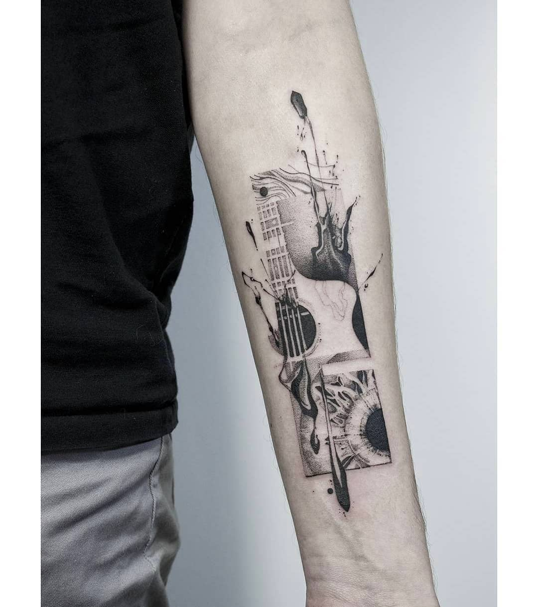 Tattoo of a guitar and an eye, tattoo with strong emotion