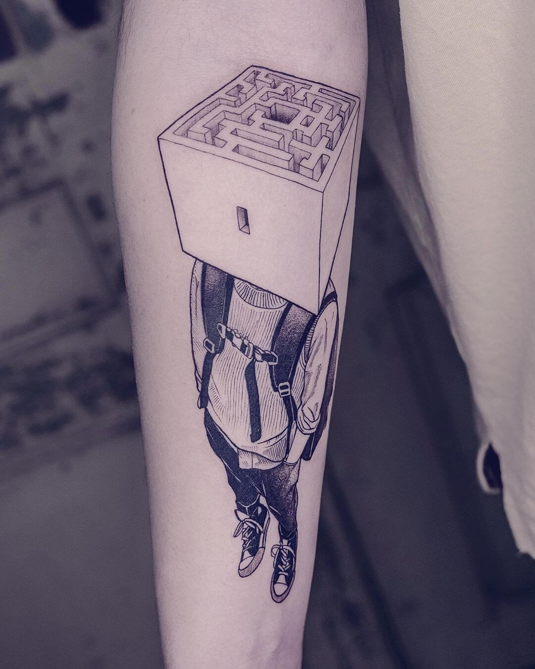 Backpacker with maze for a head, tattoo by Serena Caponera