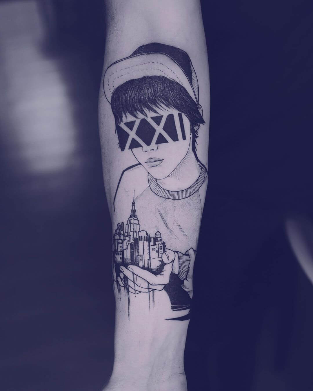 Unknown face with a city in his hands tattoo by Serena Caponera