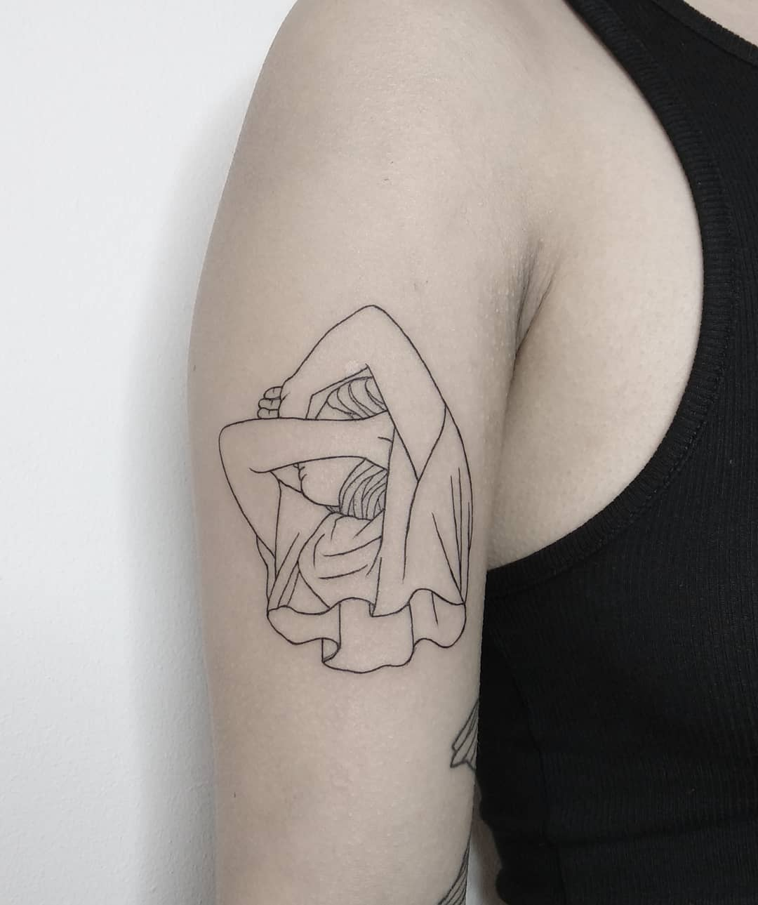 Stretching girl tattoo by Tattson