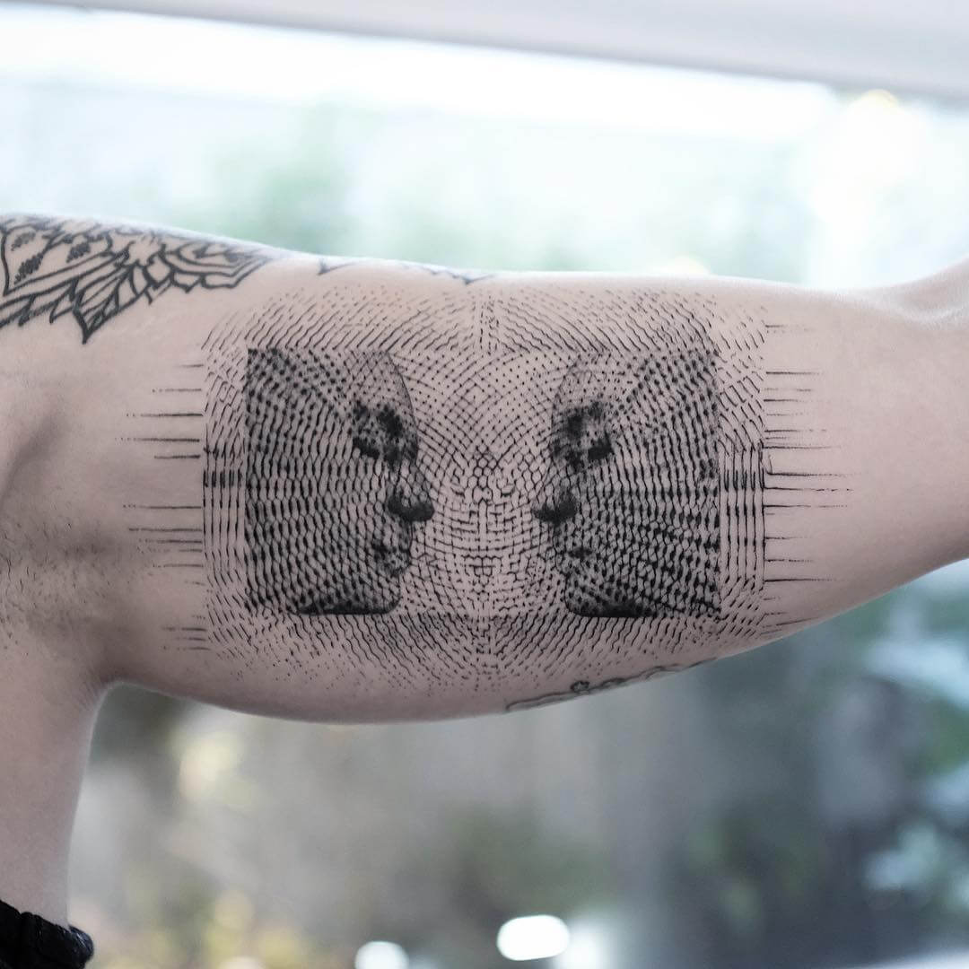 Balazs Bercsenyi facing eachother tattoo
