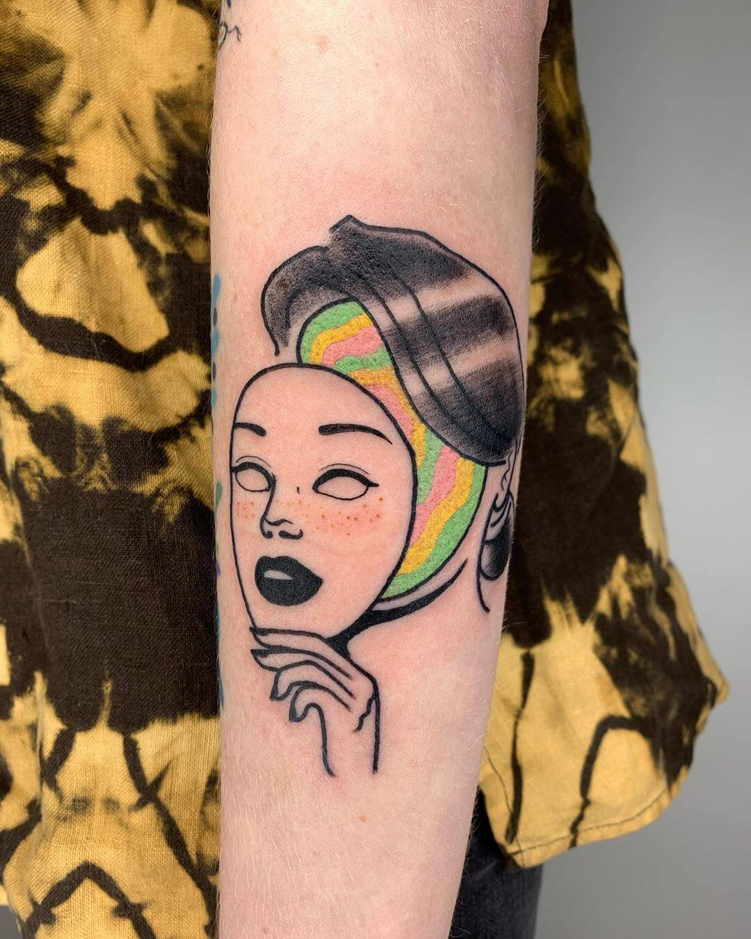 Blaabad rainbow face with mask female tattoo