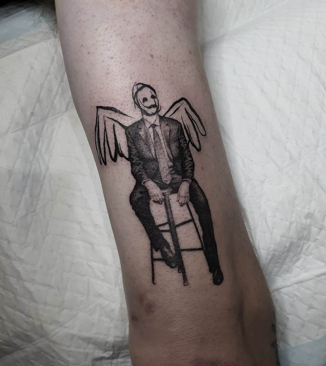 Man with wings sitting on chair tattoo by Breakkytime