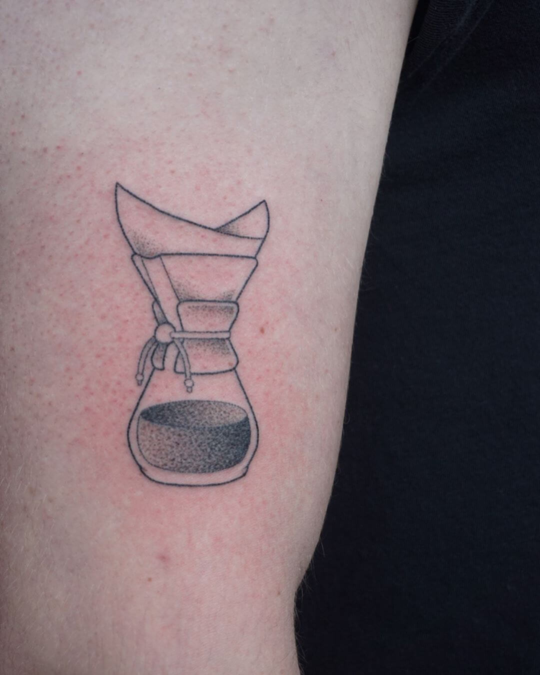 Tattoo of a coffee pot with a filter