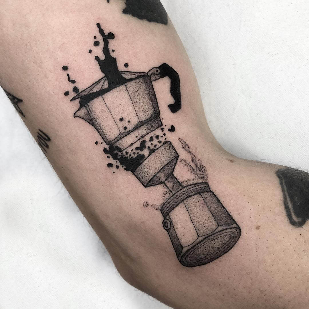 Tattoo of acoffee maker with coffee poring out