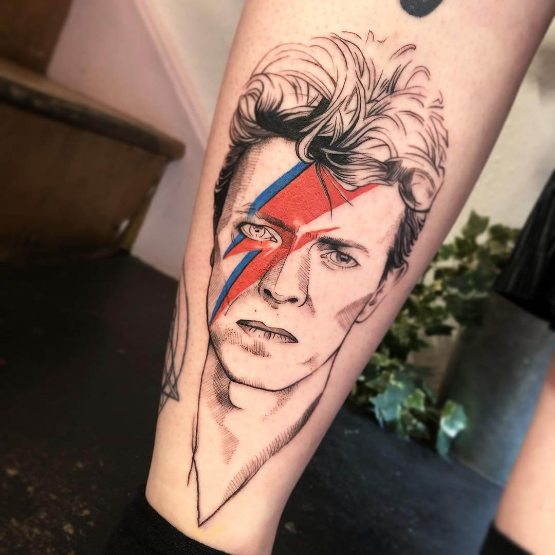 Colorful tattoo portrait of David Bowie with lightning bolt