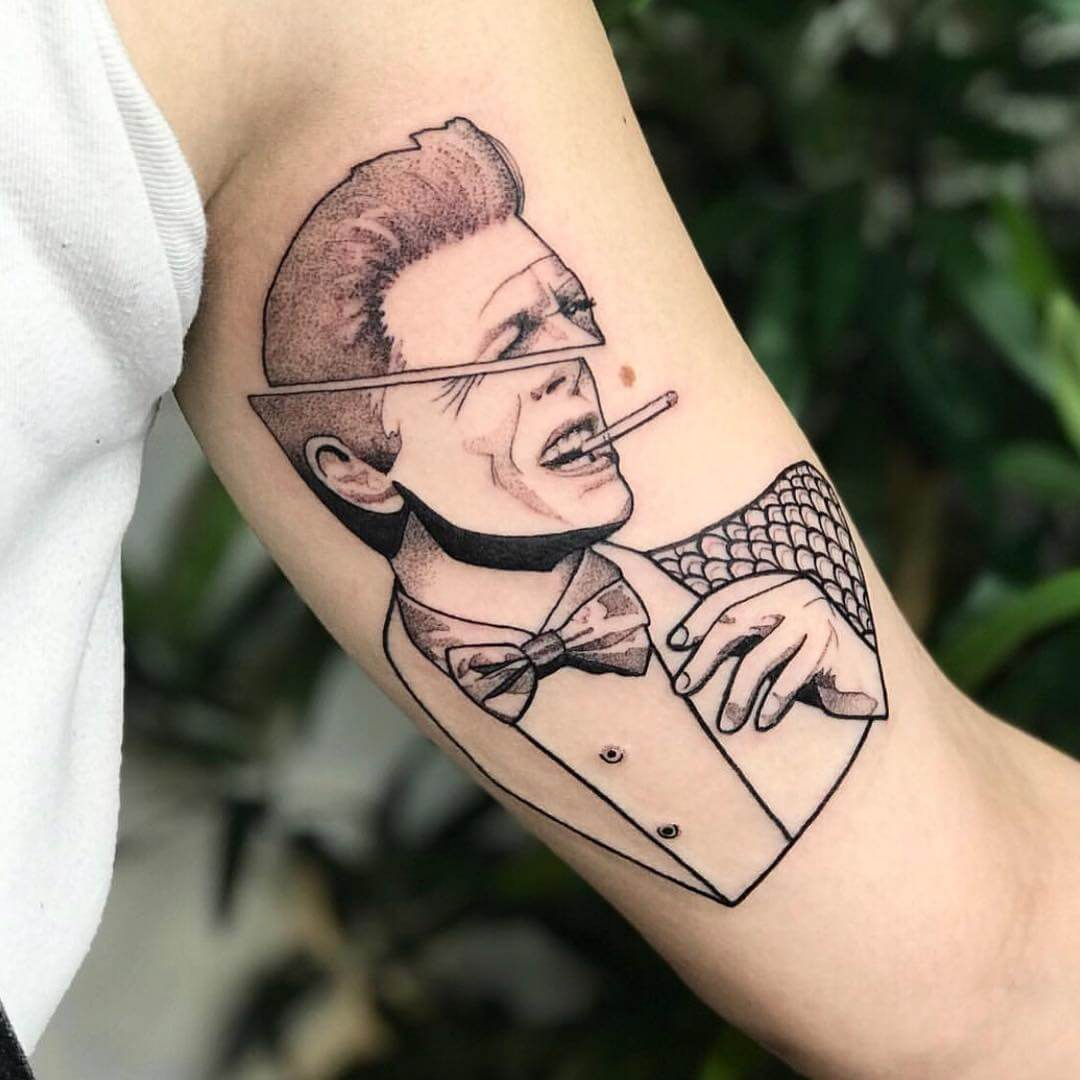 Minimal tattoo portrait of David Bowie split in two