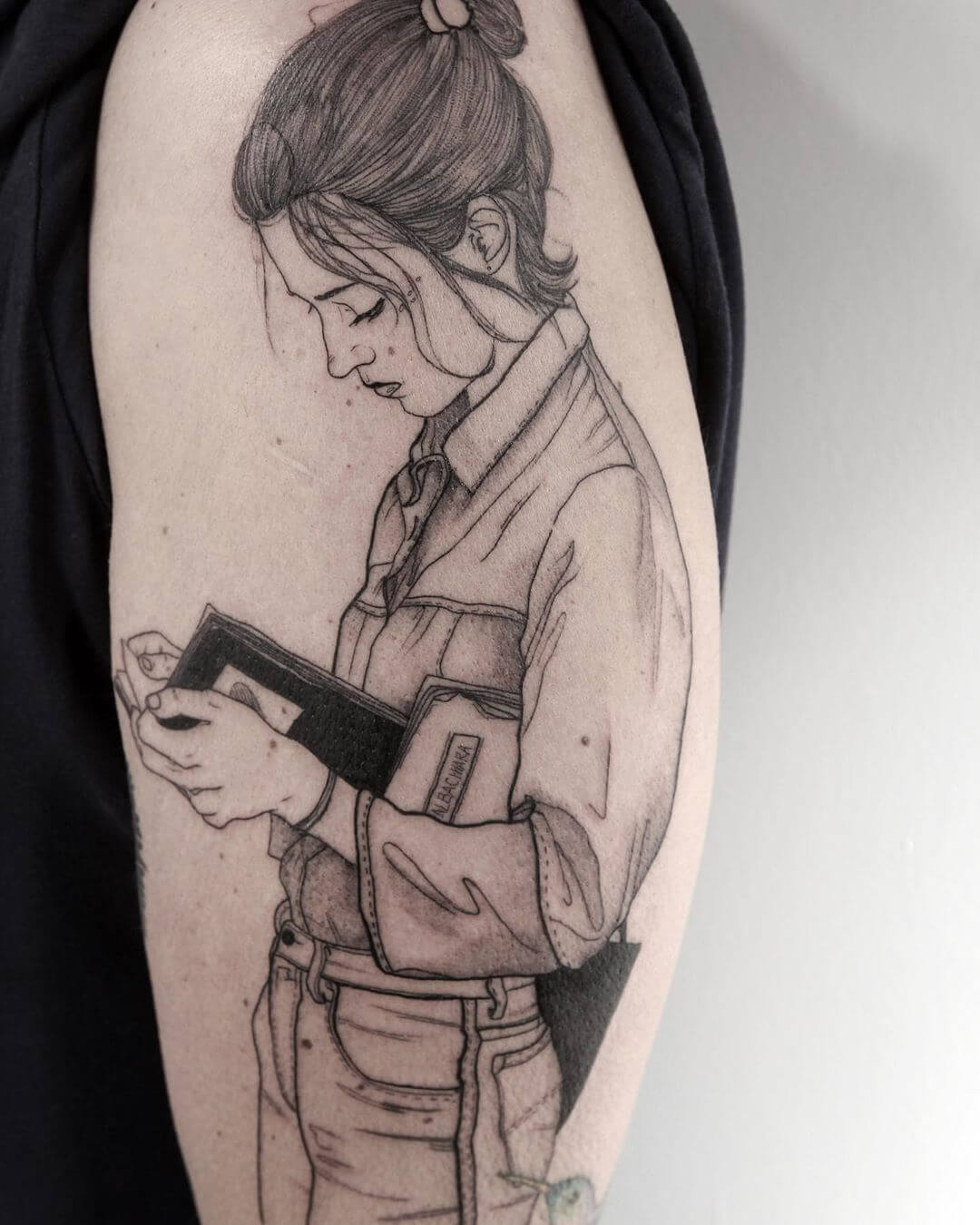 Woman reading a book tattoo by La Malafede