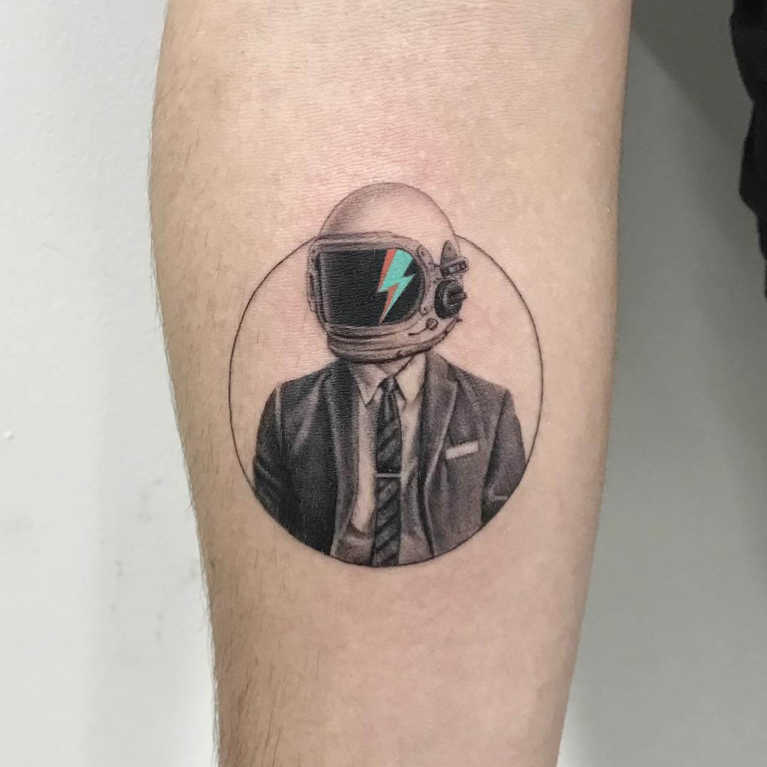 Astronaut in suit tattoo by Maya Gat