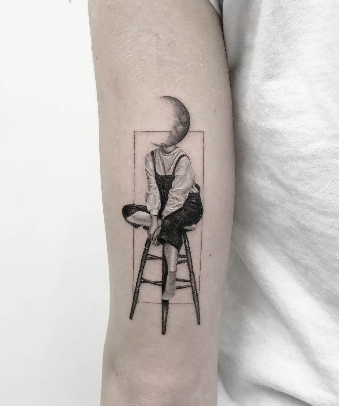 Tattoo sa girl sitting on a bar stool with a moon as head