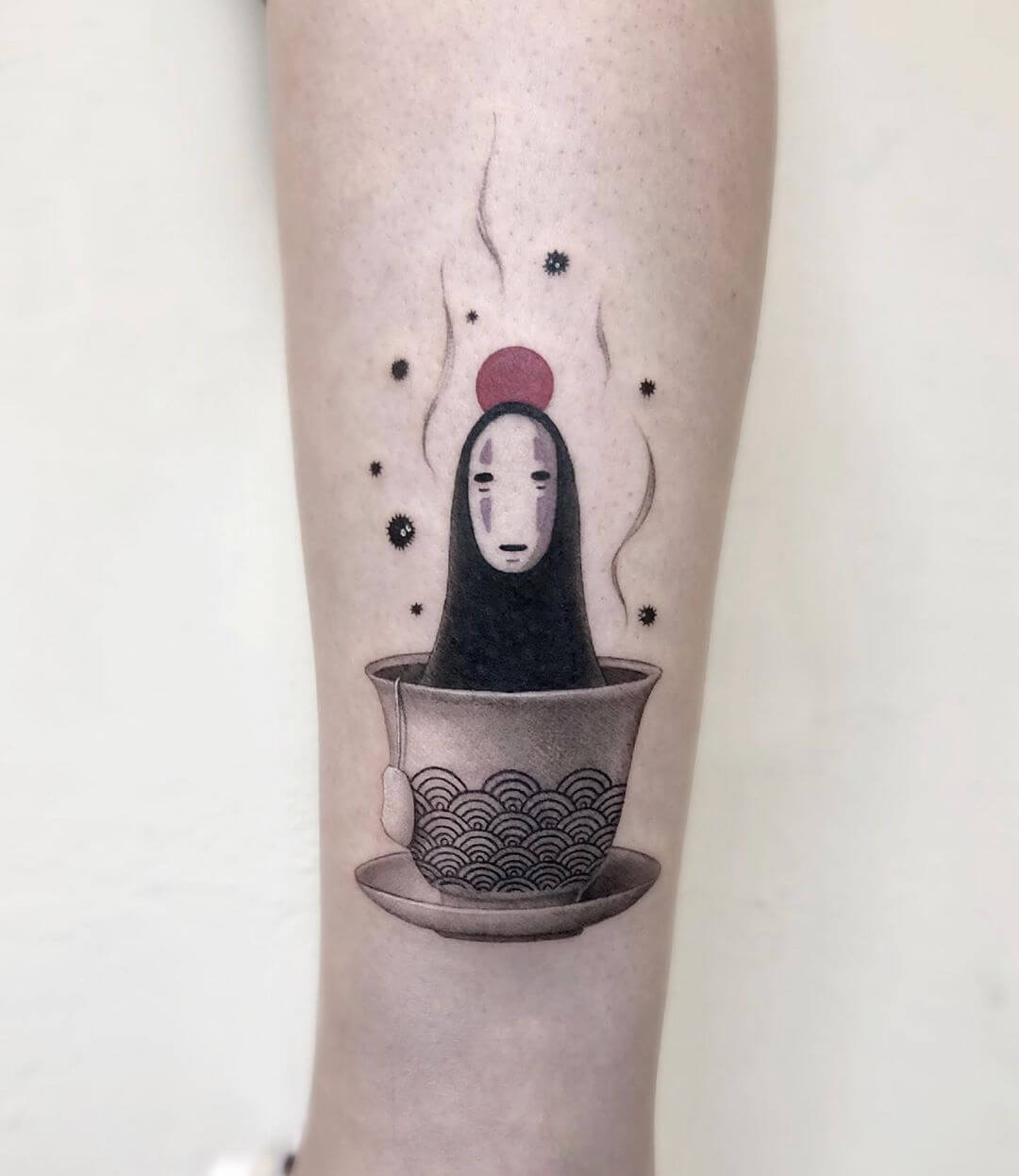 Tattoo showing Kaonashi from Spririted Away in a tea cup