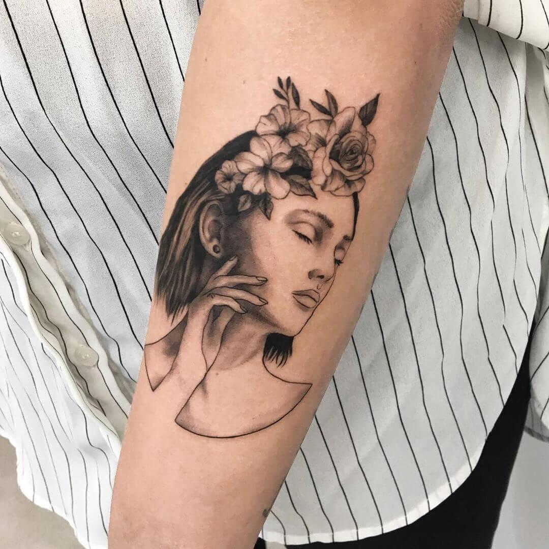 Female portrait with flowers in her hair tattoo by Paulina Szubarga