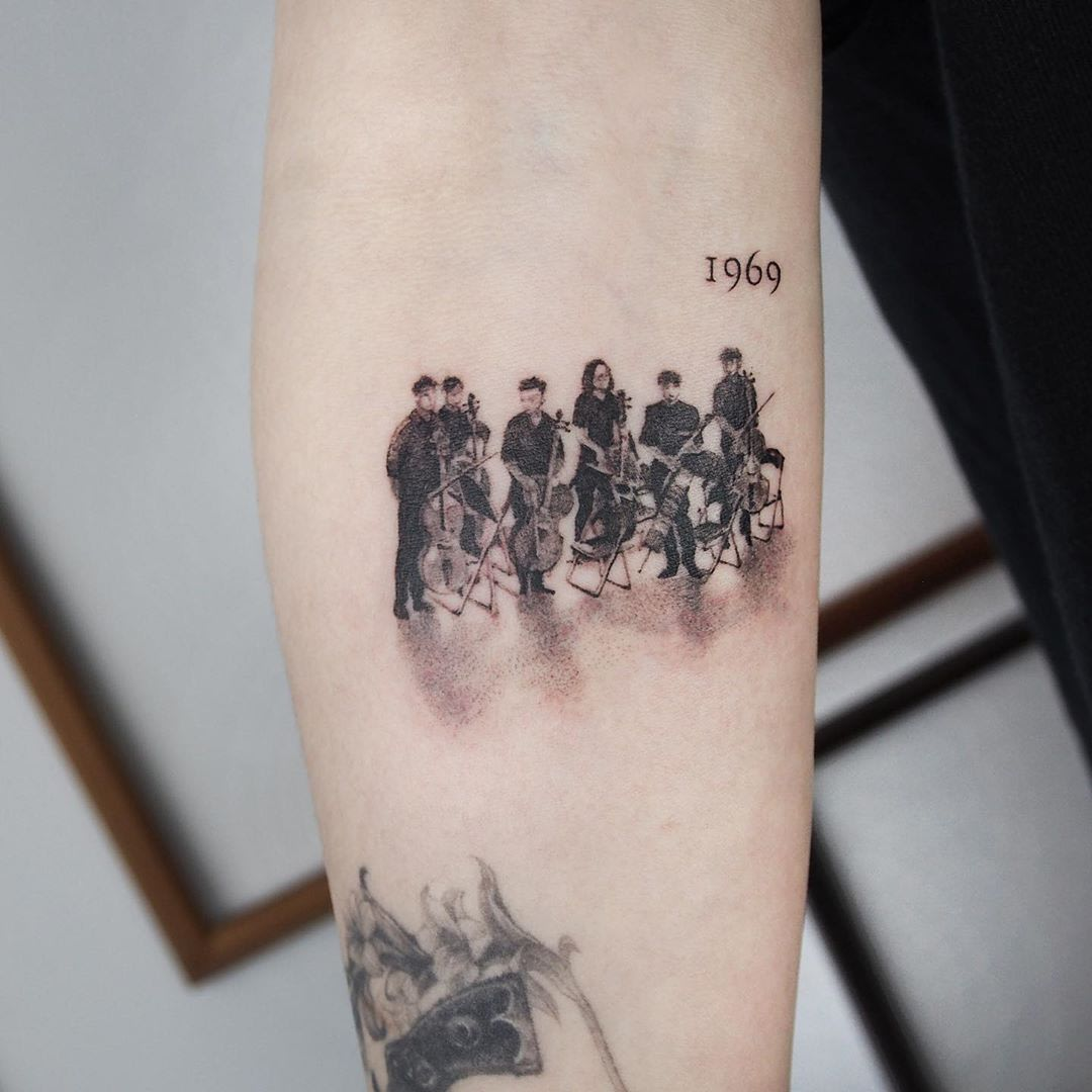 Tattoo dotwork of an orchestra