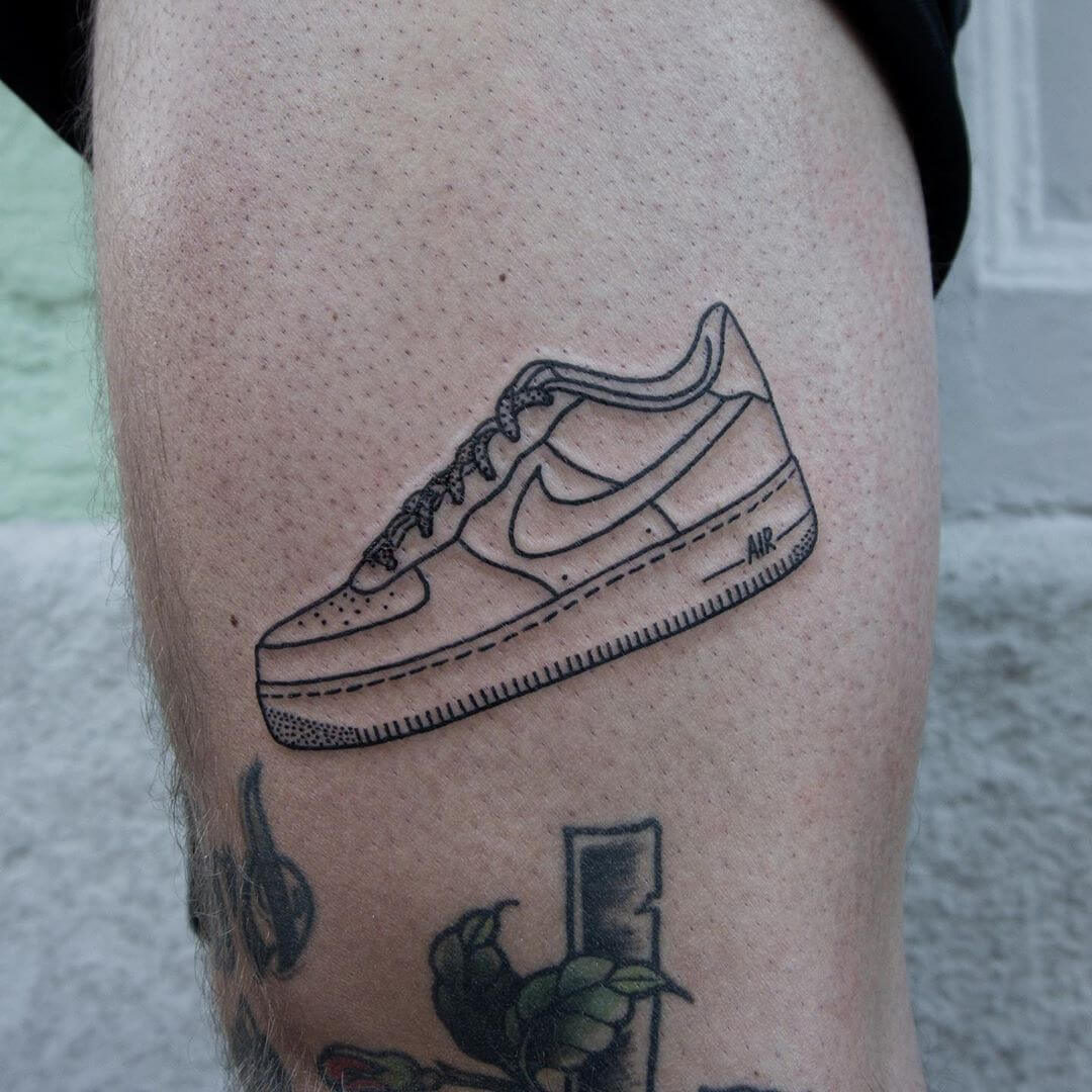 Linework tattoo of a nike sneaker