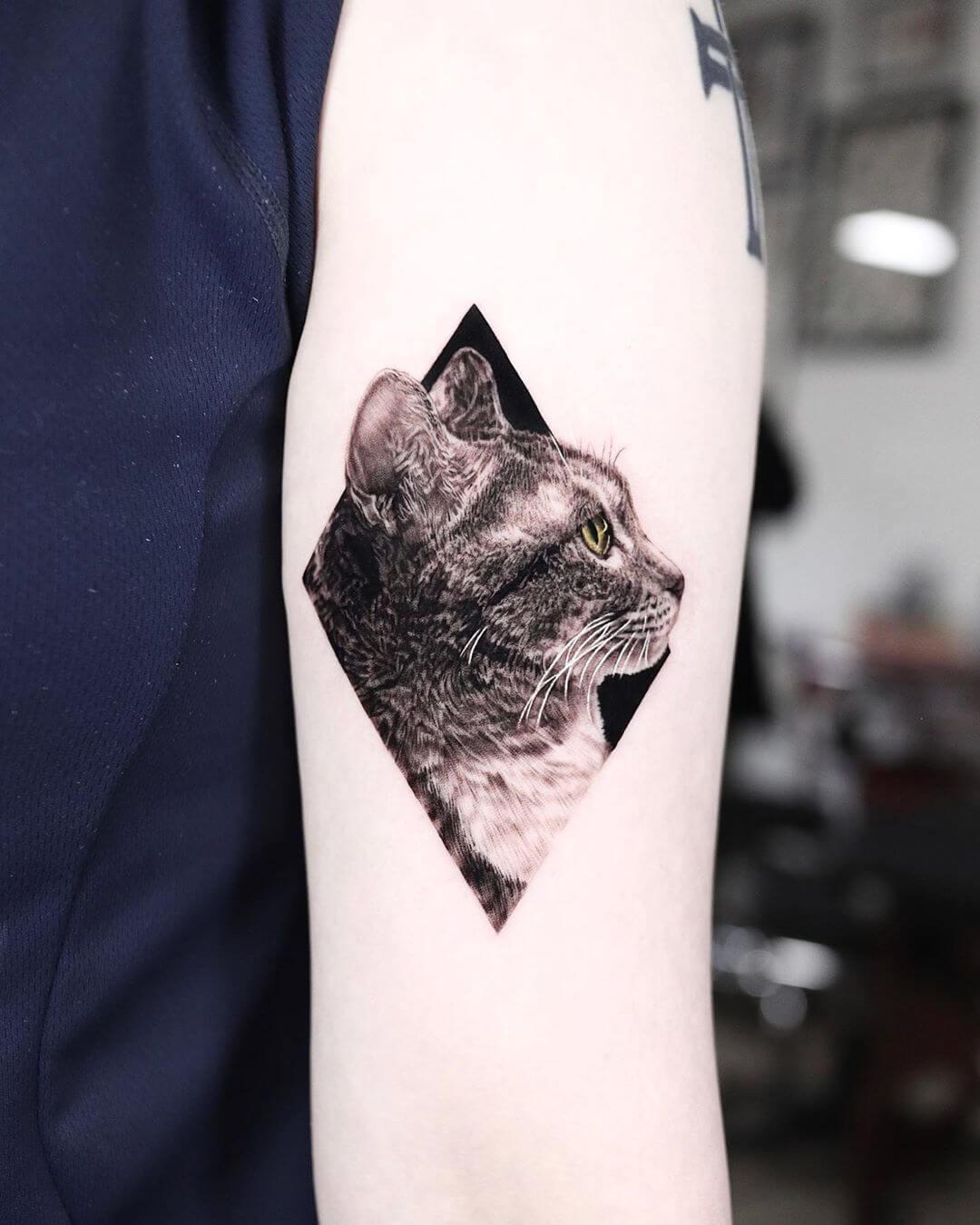 Cat side portrait tattoo by Yeono