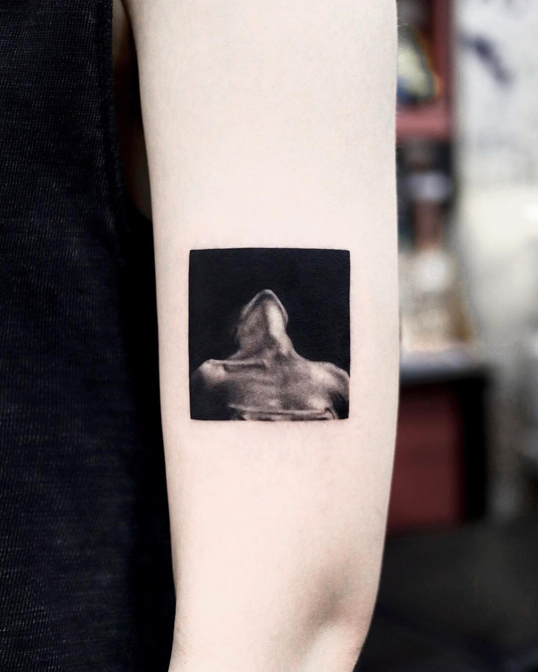 Woman leaning back black and white tattoo by Yeono