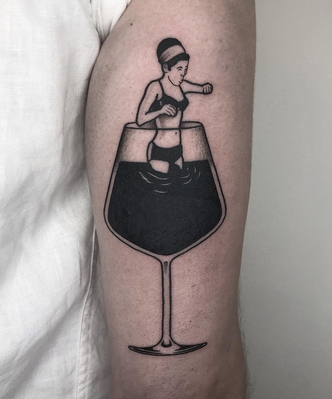 Woman in wineglass