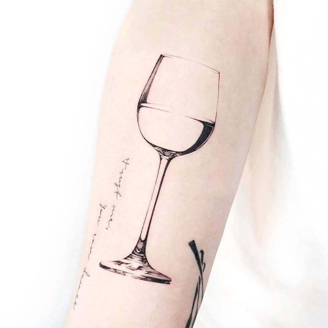 Realism tattoo glass of wine