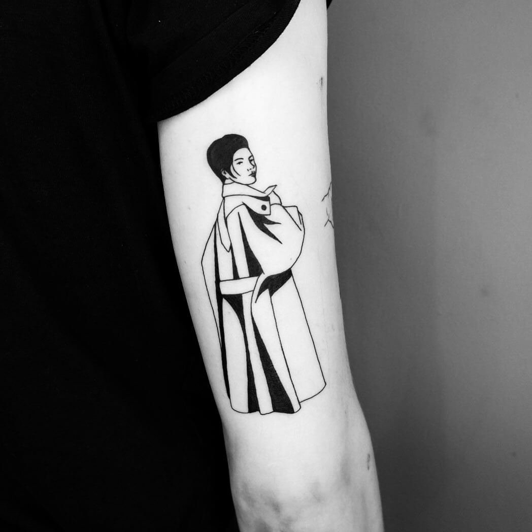Tattoo of woman in a coat looking back