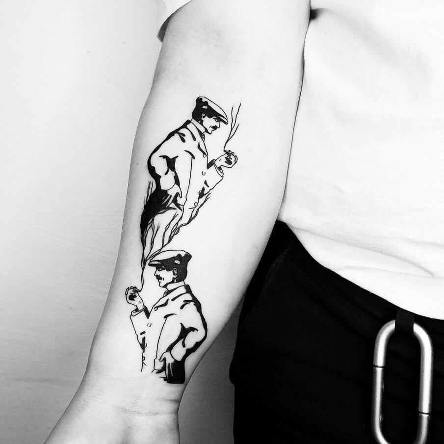 Tattoo of man smoking, the smoke also forms the man