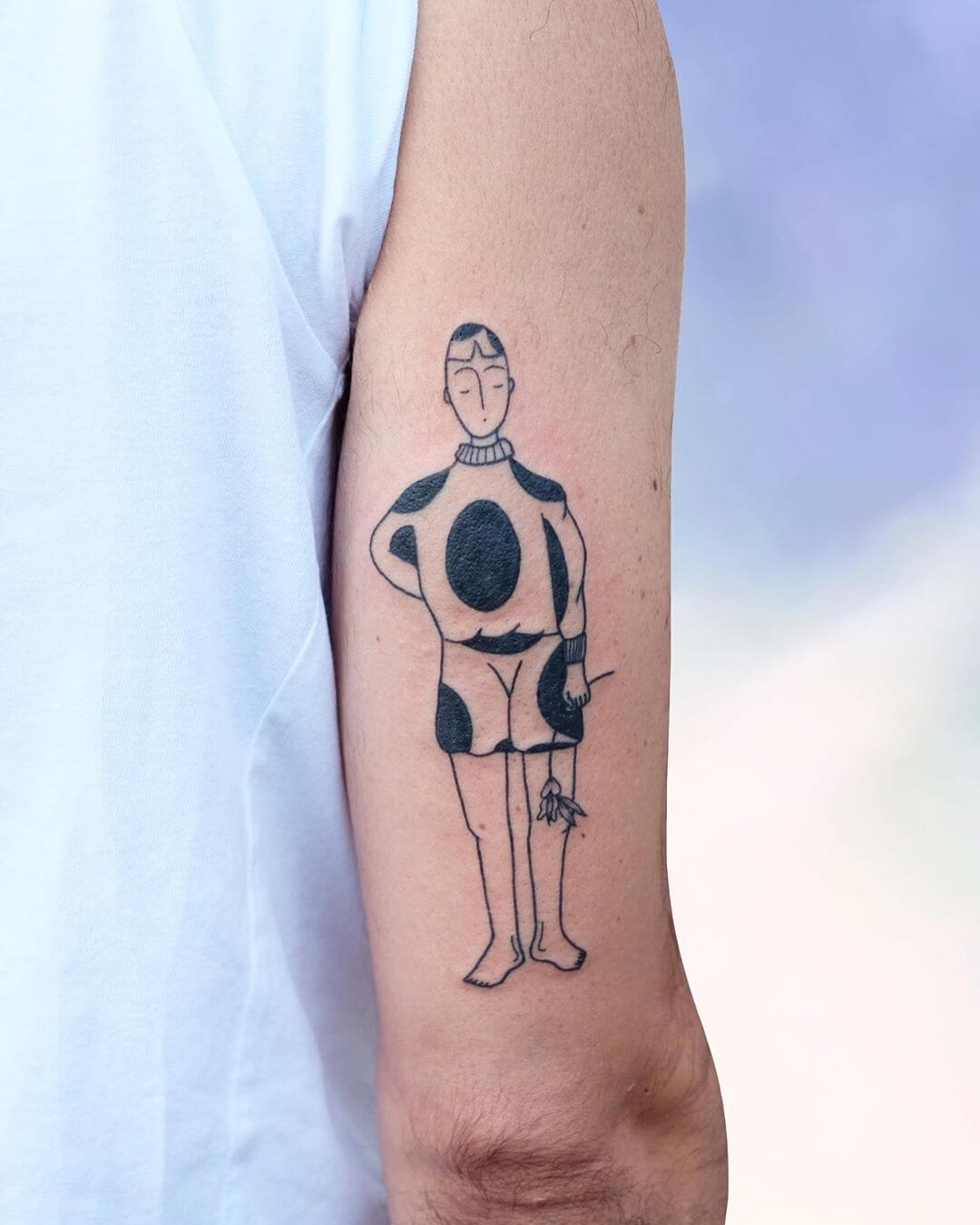 Character with dottd outfit tattoo