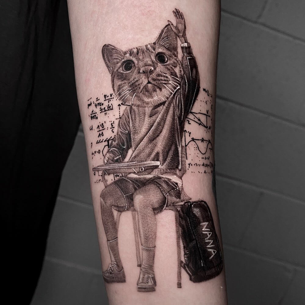 Tattoo of a cat as a person doing math