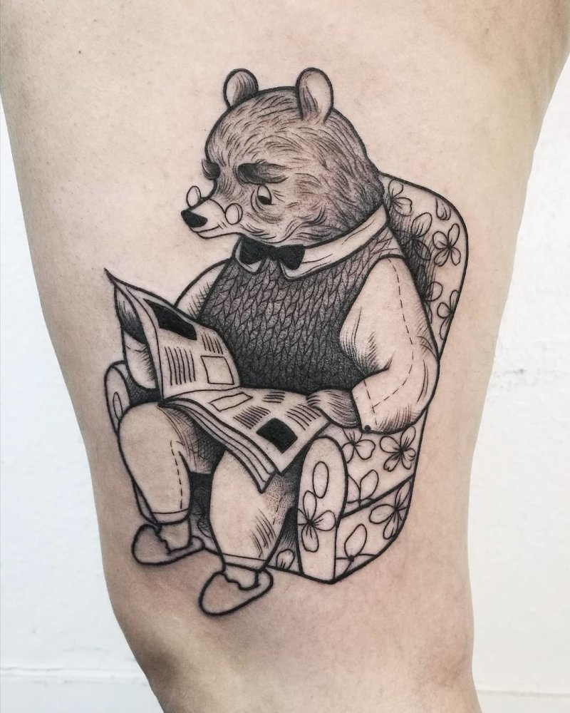 Illustrative bear reading tattoo