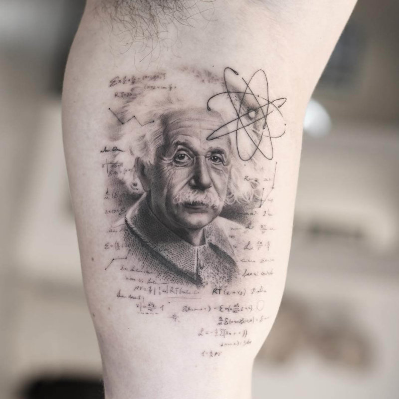 Reastic tattoo portait of Albert Einstein with theory scribbles on the background