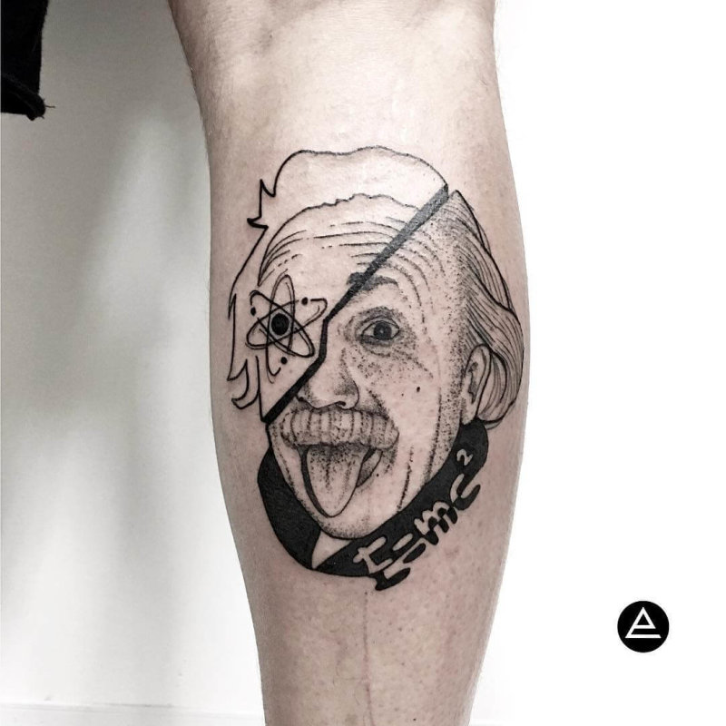 Tattoo portrait of Albert Einstein where half his face is filled with a science symbol.
