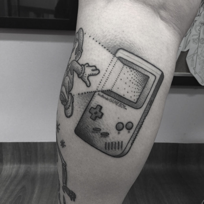 Game Boy with Mario coming out tattoo
