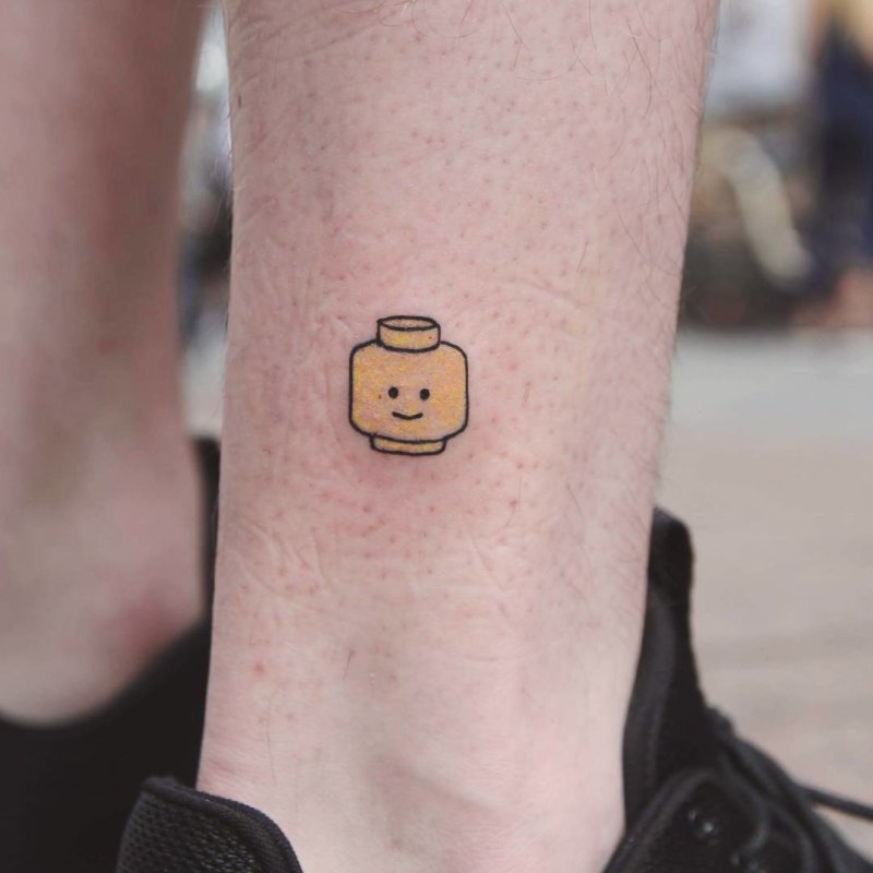 Lego head minimal tattoo