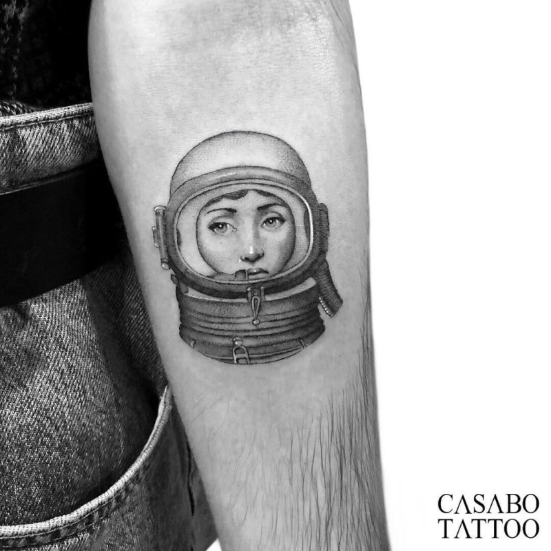 Fornasetti portrait with astronaut suit tattoo