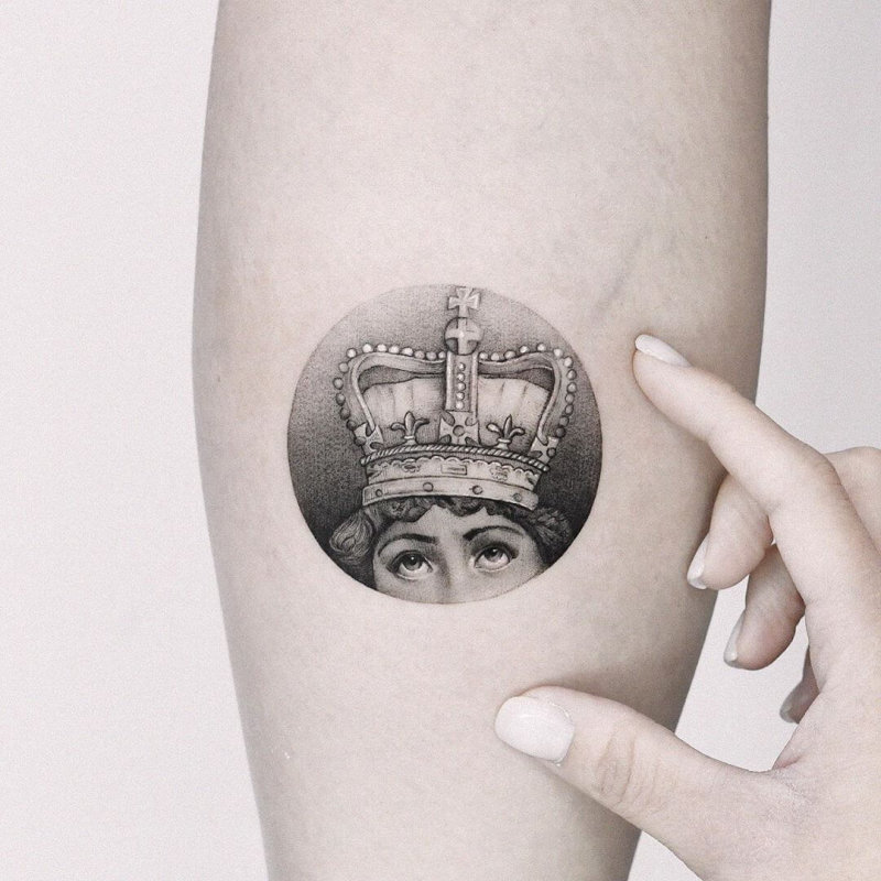Fornasetti portrait with crown tattoo