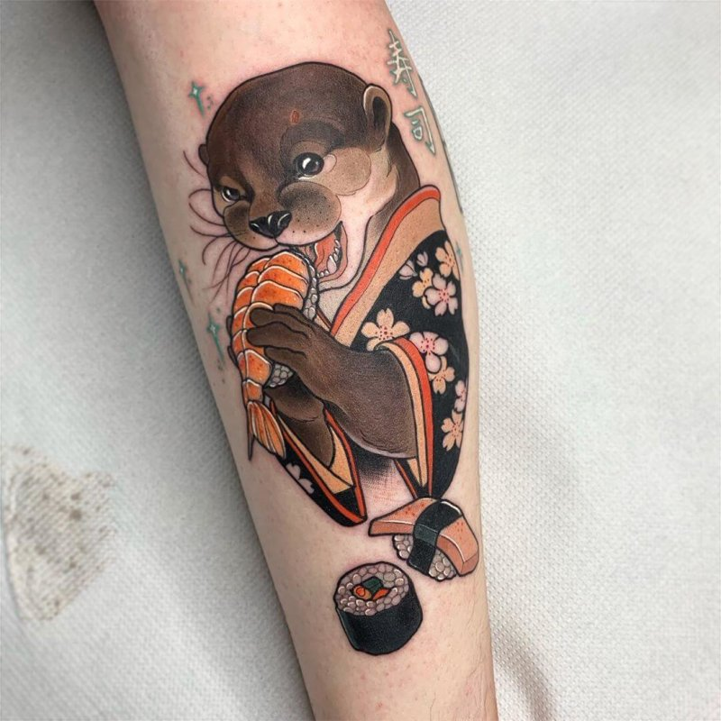 Tattoo of an otter eating sushi