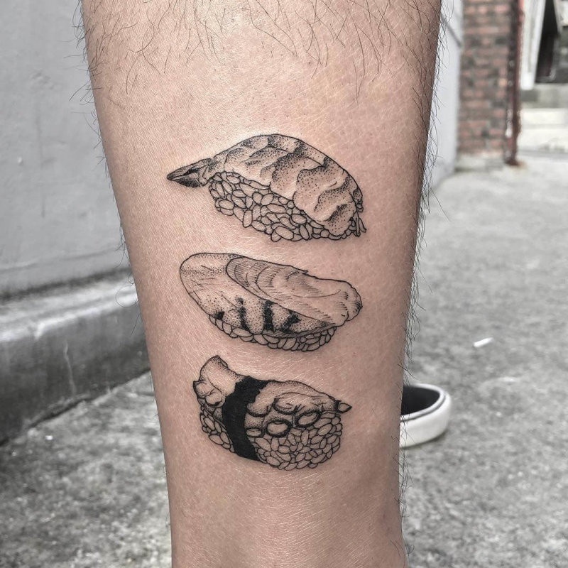 Realistic tattoo showing three forms of sushi