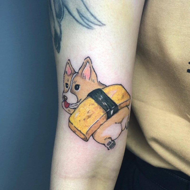 Comic dog with sushi on his back tattoo