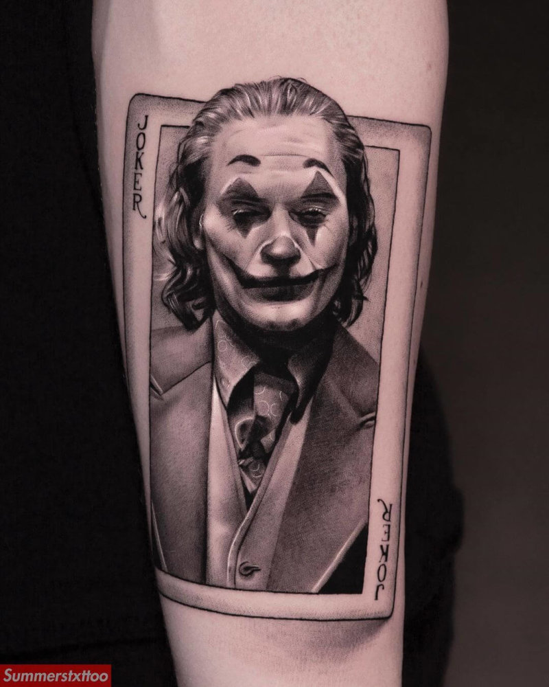 Tattoo portrait of Joaquin Phoenix as The Joker on a playing card