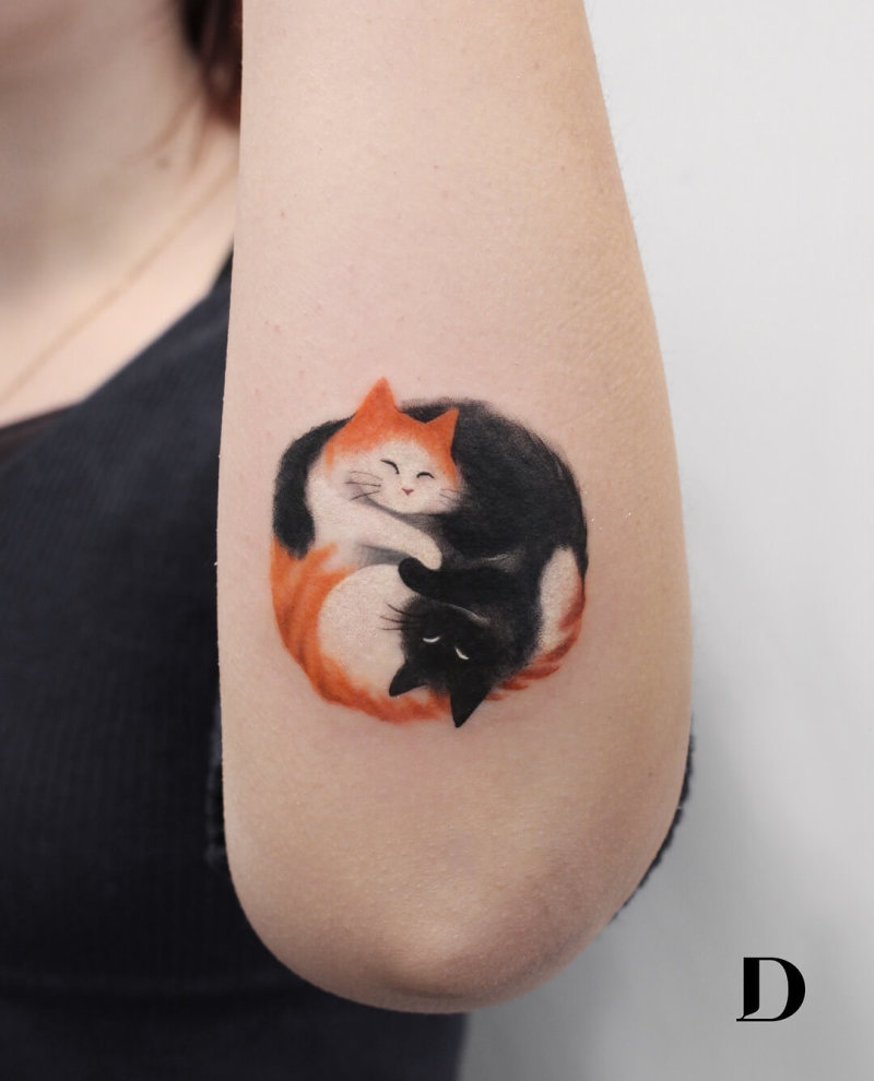 Red and black cat forming Yin Yang symbol tattoo