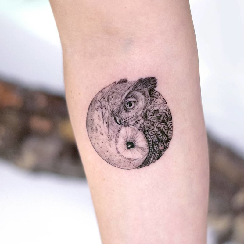 Two owls symbolizing Yin Yang symbol tattoo