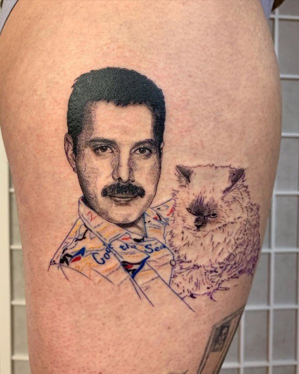 Freddy Mercury with cat tattoo by Shannon Perry