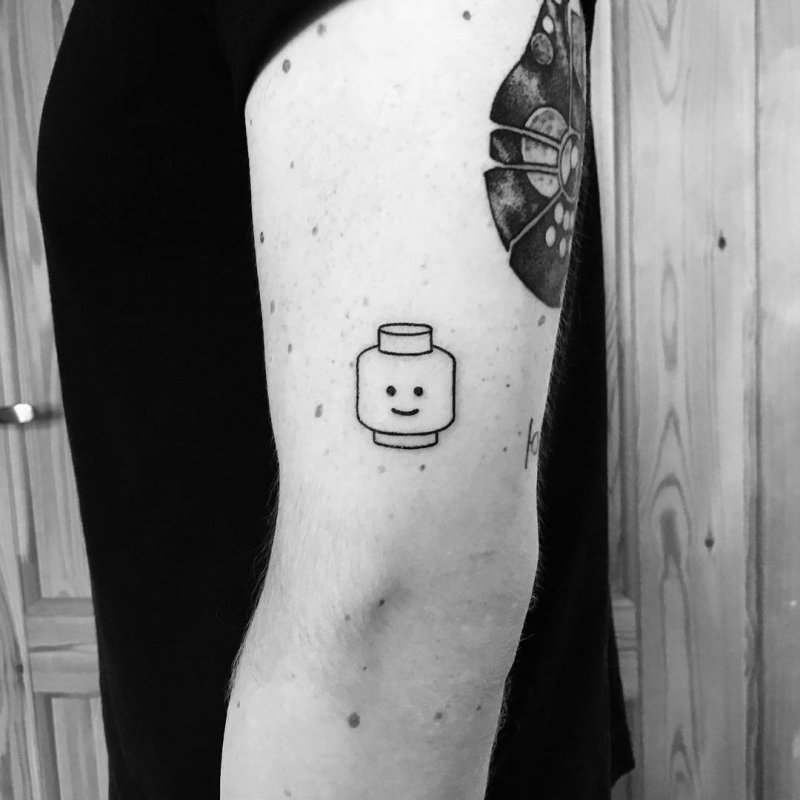 Lego figure head minimal black and white tattoo