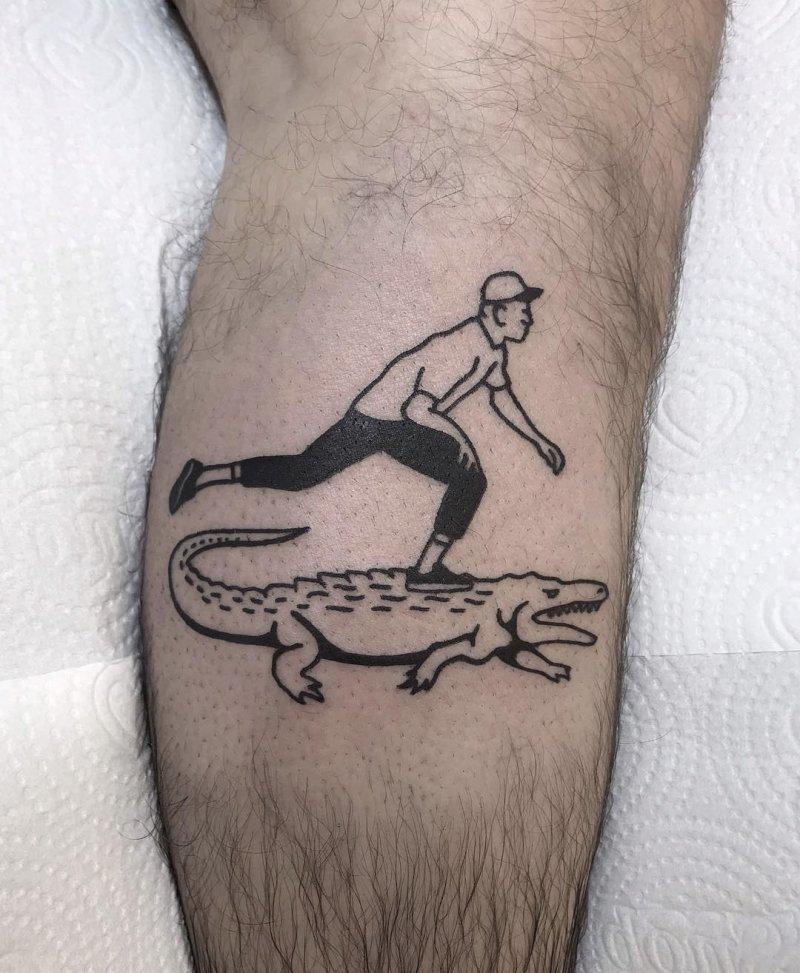 Skater on a alligator tattoo