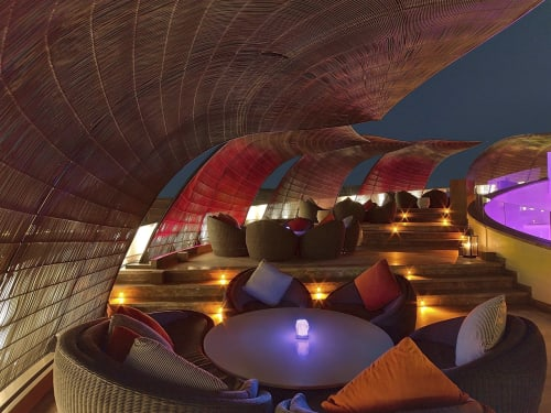 See outdoor canopy by kenneth cobonpue at nobu doha for Outdoor furniture qatar