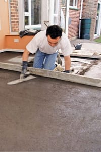 Man applying screed to floor