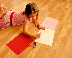 Girl on metro range wood flooring drawing